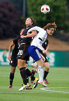 Abby Wambach (20) of the USWNT goes up for a header with Mizuho Sakaguchi (6) of Japan during the game at WakeMed Soccer Park in Cary, NC.   The USWNT defeated Japan, 2-0..