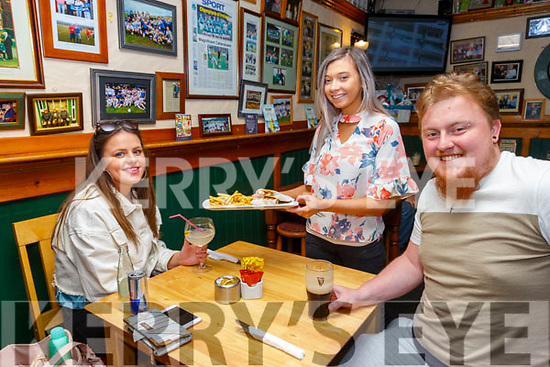 Table service only for food and drinks at Craineen's Bar & Restaurant in Cahersiveen on Monday as restrictions begin to ease pictured here l-r; Claire Sugrue, Shauna Daly & Shane Mulvihill.