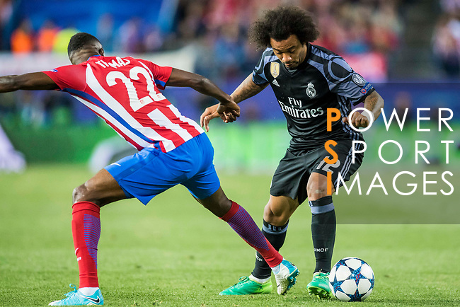Marcelo Vieira Da Silva (r) of Real Madrid battles for the ball with Thomas Teye Partey of Atletico de Madrid during their 2016-17 UEFA Champions League Semifinals 2nd leg match between Atletico de Madrid and Real Madrid at the Estadio Vicente Calderon on 10 May 2017 in Madrid, Spain. Photo by Diego Gonzalez Souto / Power Sport Images