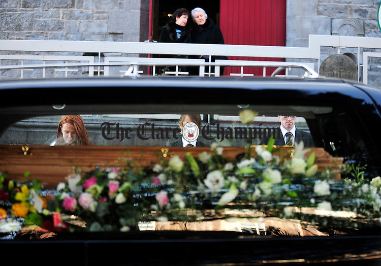 Students from The Shannon College of Hotel Management form a guard of honour during the funeral of Brendan O'Regan at Ennis Cathedral.Pic Arthur Ellis.