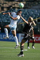 Cristiane (left) heads the ball over Leslie Osborne (right). FC Gold Pride tied the Chicago Red Stars 1-1 at Buck Shaw Stadium in Santa Clara, California on June 7th, 2009.