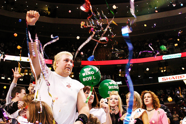 """Bill Simmons aka """"El Wingador"""" is crowned the champion at the 13th annual Wing Bowl, held in Philadelphia on February 4, 2005 at the Wachovia Center.<br /> <br /> The Wing Bowl is a competitive eating event in which eaters try and down the most hot wings in 30 total minutes in front of a crowd of 10,000 plus people.  The real show however is all around the eaters, from the various scantily clad women, known as """"Wingettes"""", that make up competitors' entourages to the behavior of the fans themselves."""