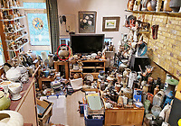 BNPS.co.uk (01202 558833)<br /> Pic: AdamPartridgeAuctioneers/BNPS<br /> <br /> Pictured: The Shurz collection fills the living room at the house in Digswell it includes a wood fired stoneware vase by Ken Matsuzaki (circled left). <br /> <br /> A huge collection of pottery and ceramics found stacked inside the suburban home of an elderly couple has sold for almost £200,000.<br /> <br /> Leonard and Alison Shurz filled every room of their three bed house with ceramic pieces they had gathered from all over the world.<br /> <br /> The Aladdin's Cave of pots, bowls, plates, vases and jugs was found by a stunned auctioneer who had the daunting task of cataloguing it all.