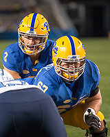 Pitt quarterback Ben DiNucci gets ready to take a snap from center Jimmy Morrissey. The North Carolina Tarheels defeated the Pitt Panthers football team 34-31 at Heinz Field, Pittsburgh, Pennsylvania on November 9, 2017.