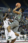 Green Valley's Lorenzo Jarvis goes for a shot against Hugh's Samuel Williams during a semi-final game in the NIAA 4A State Basketball Championships between Hug and Green Valley high schools at Lawlor Events Center in Reno, Nev, on Thursday, Feb. 23, 2012. .Photo by Cathleen Allison
