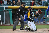 John Hester (22) of the Salt Lake Bees behind the plate with home plate umpire Jordan Ferrell in action with the Las Vegas 51s at Smith's Ballpark on May 8, 2014 in Salt Lake City, Utah.  (Stephen Smith/Four Seam Images)