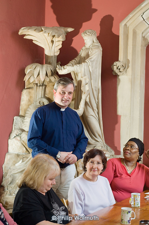Reverand Jeremy Alcock talks to members of Open Age, a  group for the over-50s, at St.Stephens Church, Bayswater, London