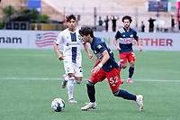FOXBOROUGH, MA - JULY 4: Michael Tsicoulias #52 of the New England Revolution II prepares to pass the ball in the Greenville Triumph SC half during a game between Greenville Triumph SC and New England Revolution II at Gillette Stadium on July 4, 2021 in Foxborough, Massachusetts.