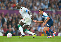 July 26, 2012..Britain's Neil Taylor (2) and Senegal's Mohamed Diame (13). Great Britain vs Senegal Football match during 2012 Olympic Games at Old Trafford in Manchester, England. Senegal held Great Britain to a 1-1 draw...(Credit Image: © Mo Khursheed/TFV Media)