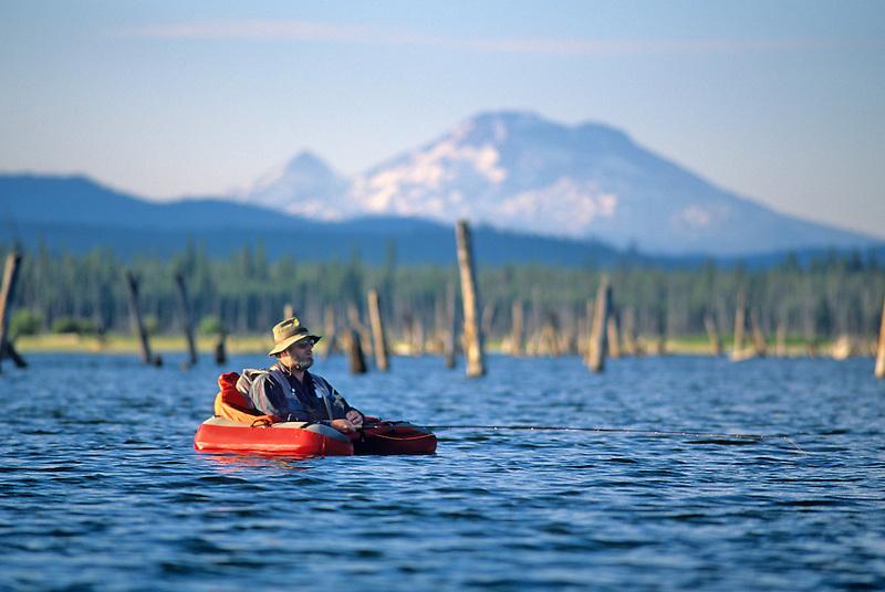Fly fisherman in float tube. Crane Prairie, Oregon.
