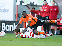 :: DUNDEE UTD'S PRINCE BUABEN IS BROUGHT DOWN BY HAMILTON'S GARY MCDONALD ::