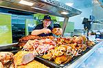 Sharon Lyne re stocking the deli counter in David Powers GALA shop in Abbeydorney