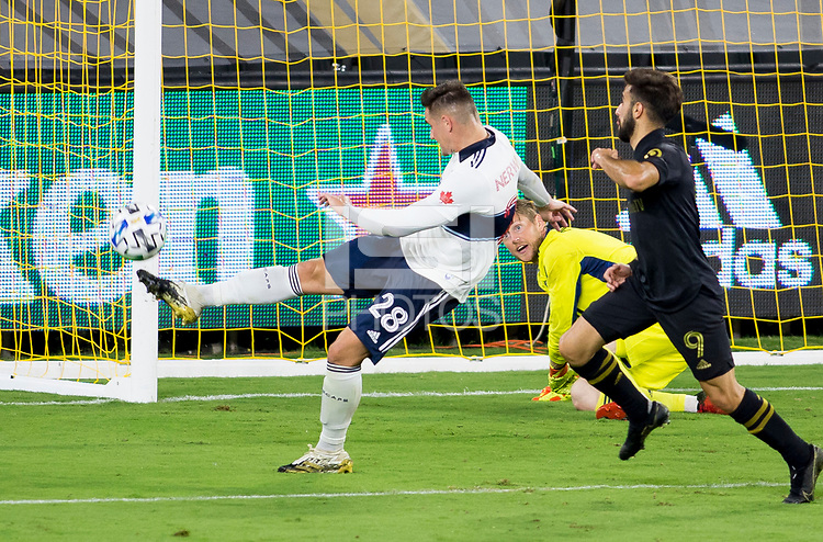 LOS ANGELES, CA - SEPTEMBER 23: Jake Nerwinski #28 of the Vancouver Whitecaps clears a ball from the box during a game between Vancouver Whitecaps and Los Angeles FC at Banc of California Stadium on September 23, 2020 in Los Angeles, California.