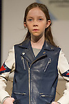 Model walks runway in an outfit by Diesel Kid, during the petitePARADE Children's Club fashion show at the Jacob Javits Center in New York City, on January 9, 2016.