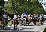 Elko County rancher Grant Gerber, in the white hat on the wagon, and about 40 people on horseback, arrived at the Capitol in Carson City, Nev., on Friday, May 30, 2014, to deliver a petition to the governor calling attention to the ongoing fight between ranchers and the BLM over grazing on public lands. <br /> Photo by Cathleen Allison