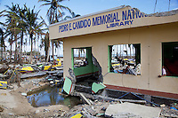 Philippines. Province Eastern Samar. Hernani. Pedro E. Candido Memorial National Library destroyed by typhoon Haiyan's winds and storm surge. Typhoon Haiyan, known as Typhoon Yolanda in the Philippines, was an exceptionally powerful tropical cyclone that devastated the Philippines. Haiyan is also the strongest storm recorded at landfall in terms of wind speed. Typhoon Haiyan's casualties and destructions occured during a powerful storm surge, an offshore rise of water associated with a low pressure weather system. Storm surges are caused primarily by high winds pushing on the ocean's surface. The wind causes the water to pile up higher than the ordinary sea level. 24.11.13 © 2013 Didier Ruef