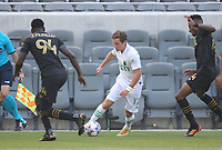 LOS ANGELES, CA - APRIL 17: Jon Gallagher #17 of Austin FC moves  with the ball during a game between Austin FC and Los Angeles FC at Banc of California Stadium on April 17, 2021 in Los Angeles, California.