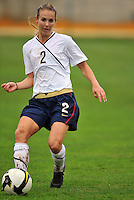 Heather Mitts passes the ball. The USA defeated Norway 2-1 at Olhao Stadium on February 26, 2010 at the Algarve Cup.