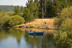 People boating and fishing on the Deschutes River at Sunriver, Central Oregon
