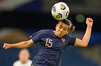 LE HAVRE, FRANCE - APRIL 13: Kenzi Dali #15 of France with a beautiful head ball during a game between France and USWNT at Stade Oceane on April 13, 2021 in Le Havre, France.
