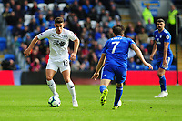 Ashley Westwood of Burnley battles with Harry Arter of Cardiff City during the Premier League match between Cardiff City and Burnley at Cardiff City Stadium in Cardiff, Wales, UK. Sunday 30 September 2018