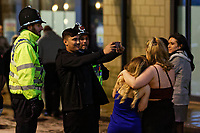 Pictured: A man takes a selfie with police officers. Sunday 31 December 2017 and 01 January 2018<br /> Re: New Year revellers in Wind Street, Swansea, Wales, UK