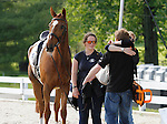 LEXINGTON, KY - APRIL 28: Connections of #10 Bango and rider Tim Price from New Zealand embrace after an 8th place ride in the Dressage test in the Rolex Three Day Event, Dressage Day 1, at the Kentucky Horse Park in Lexington, KY.  April 28, 2016 in Lexington, Kentucky. (Photo by Candice Chavez/Eclipse Sportswire/Getty Images)