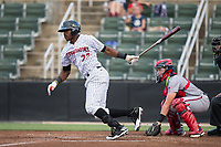 Micker Adolfo (27) of the Kannapolis Intimidators follows through on his swing against the Hagerstown Suns at Kannapolis Intimidators Stadium on June 14, 2017 in Kannapolis, North Carolina.  The Intimidators defeated the Suns 10-1 in game two of a double-header.  (Brian Westerholt/Four Seam Images)