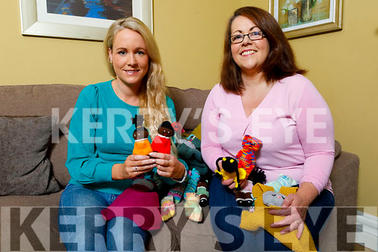 Louise Quill receives hand made dolls made by Emer McDaid for the Tir na nOg Orphanage in Tanzania at Emer's home on Monday.