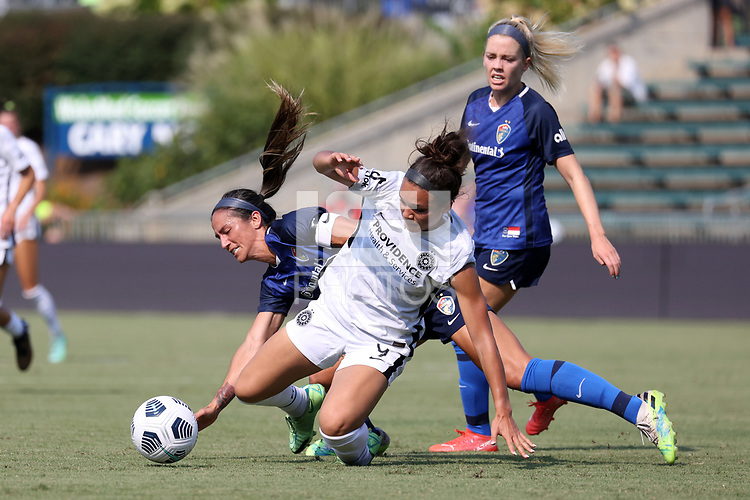CARY, NC - SEPTEMBER 12: Sophia Smith #9 of the Portland Thorns FC and Abby Erceg #6 of the North Carolina Courage get tangled up while challenging for the ball during a game between Portland Thorns FC and North Carolina Courage at Sahlen's Stadium at WakeMed Soccer Park on September 12, 2021 in Cary, North Carolina.