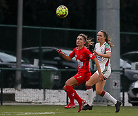 (Left to right) Stephanie Suenens of Woluwe (17) and Estee Cattoor of OHL (11) battle for the ball  during a female soccer game between Oud Heverlee Leuven and Femina White Star Woluwe  on the 5 th matchday of the 2020 - 2021 season of Belgian Womens Super League , Sunday 18 th of October 2020  in Heverlee , Belgium . PHOTO SPORTPIX.BE | SPP | SEVIL OKTEM
