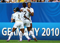 USA's Zakiya Bywaters (R) celebrates after scoring 3:0 with Toni Pressley (C) and Crystal Dunn (L) during the FIFA U20 Women's World Cup at the Rudolf Harbig Stadium in Dresden, Germany on July 17th, 2010.