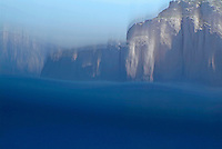 Rock sea cliffs and blue waters surrounding Riou Island, France.