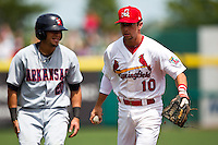 Greg Garcia (10) of the Springfield Cardinals tags out a base runner during a game against the Arkansas Travelers at Hammons Field on May 8, 2012 in Springfield, Missouri. (David Welker/ Four Seam Images).