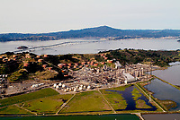 aerial photograph of the Chevron Richmond Refinery, Richmond, Contra Costa County, California, Richmond San Rafael Bridge and Mount Tamalpais in the background