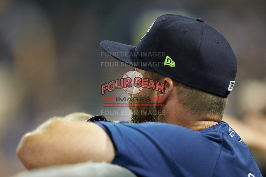 Columbia Fireflies pitching coach Royce Ring (32) watches from the dugout during the game against the Rome Braves at Segra Park on May 13, 2019 in Columbia, South Carolina. The Fireflies defeated the Braves 6-1 in game two of a doubleheader. (Brian Westerholt/Four Seam Images)