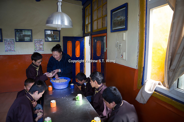 Tibetan carer Lhakdon makes Tsampa, a traditional local food, for blind and visually impaired Tibetan students during breakfast at the canteen of the School for the Blind in Tibet, in the capital city of Lhasa, September 2016.