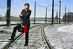 Fashion. Juanita Chacon, realtor and RTD director for district C, out on the light rail tracks at Union Station on February 13, 2007.