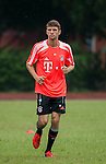 Thomas Muller of Bayern Munich during a training session ahead the friendly match against VfL Wolfsburg as part of the Audi Football Summit 2012 on July 26, 2012 at the Tianhe Sports Stadium in Guangzhou, China. Photo by Victor Fraile / The Power of Sport Images