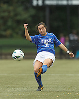Duke University defender Christina Gibbons (31) centers the ball.Boston College (white) defeated Duke University (blue/white), 4-1, at Newton Campus Field, on October 6, 2013.