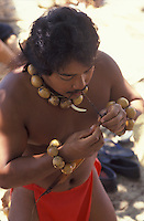 Young Hawaiian man demonstrating how ancient Hawaiians made twine.