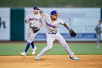 Midland RockHounds shortstop Richie Martin (12) throws to first base during a game against the Northwest Arkansas Naturals on May 27, 2017 at Arvest Ballpark in Springdale, Arkansas.  NW Arkansas defeated Midland 3-2.  (Mike Janes/Four Seam Images)