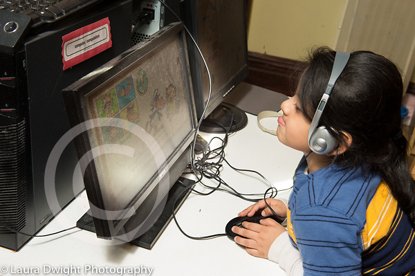 Education Preschool 3-4 year olds boy playing educationalb game on computer