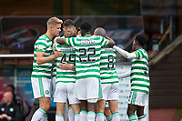 22nd August 2020; Tannadice Park, Dundee, Scotland; Scottish Premiership Football, Dundee United versus Celtic; Albian Ajeti of Celtic is congratulated by team mates after scoring for 0-1
