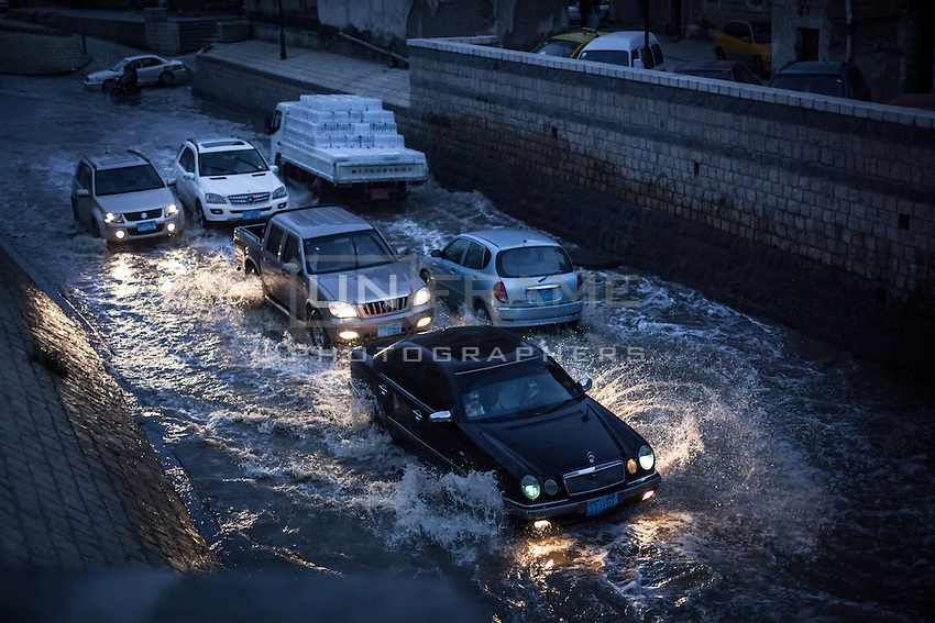 """Flooded street in Old Sanaa during Ramadan, the rainy season. This photo was taken right before """"Magreb"""", the prayer call to break the fast."""