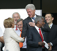 Former U.S. President William Jefferson Clinton shakes hands with German Chancellor Angela Merkel before the game.  Italy defeated France on penalty kicks after leaving the score tied, 1-1, in regulation time in the FIFA World Cup final match at Olympic Stadium in Berlin, Germany, July 9, 2006.