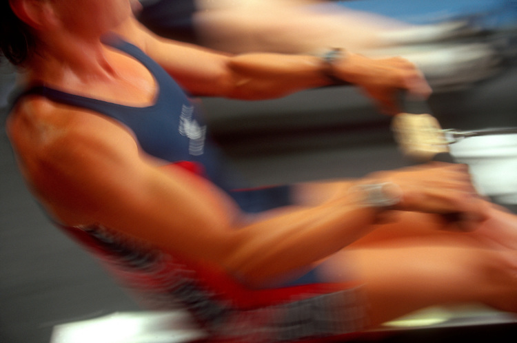 """Exercise, Rowing, Woman on a rowing machine: National Rowing Team lightweight woman """"erging"""" on an ergonometer, ARCO Olympic Training Center, Chula Vista, California."""