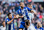 Victor Laguardia Cisneros (C) of Deportivo Alaves competes for the ball with Karim Benzema (R) of Real Madrid during the La Liga 2017-18 match between Real Madrid and Deportivo Alaves at Santiago Bernabeu Stadium on February 24 2018 in Madrid, Spain. Photo by Diego Souto / Power Sport Images