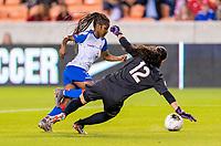 HOUSTON, TX - FEBRUARY 3: Batcheba Louis #7 of Haiti goes around Sasha Fabrega #12 of Panama during a game between Panama and Haiti at BBVA Stadium on February 3, 2020 in Houston, Texas.