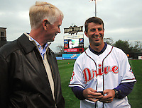 "April 13, 2009: Clemson head football coach Dabo Swinney, right, talks with Greenville Drive president Craig Brown before Monday night's 2009 Drive opener. Swinney, who was to throw out the first pitch, told Brown that Clemson football player C.J. Spiller had just sent him a text message, imploring him ""Don't pull your hamstring"" when throwing the pitch. Photo by: Tom Priddy/Four Seam Images"